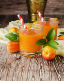 Fresh apricot juice in glass on wooden table, selective focus Stock Photo