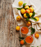 Fresh apricot juice in glass on wooden table, selective focus Royalty Free Stock Photos