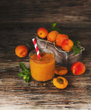 Fresh apricot juice in glass on wooden table, selective focus Royalty Free Stock Photo