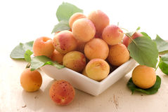 Fresh apricots. Fresh sweet apricots and the bowl (horizontal Stock Photography