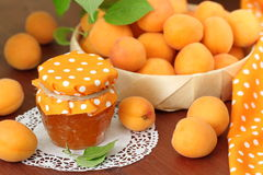 Fresh apricots and apricot jam royalty free stock photography