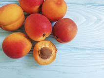 Fresh apricots on a blue wooden background. Refreshmentn Stock Images
