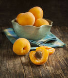 Fresh apricots in bowl Stock Photos