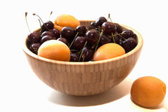 Fresh apricots and cherry in a bowl Royalty Free Stock Images