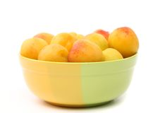 Fresh apricots in cup isolated on white Royalty Free Stock Photos