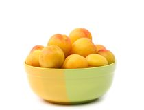 Fresh apricots in cup isolated on white Stock Image