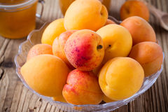 Fresh apricots in glass bowl and homemade apricot chutney Royalty Free Stock Photography