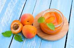 Fresh apricots with jam in glass jar royalty free stock image
