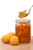 Fresh apricots and jam in a jar Stock Photography