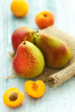 Fresh apricots and pears Stock Image