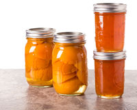 Fresh Apricots preserved in jars Stock Photo