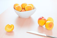 Fresh Apricots table knife on wooden background Stock Photo