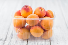 Fresh Apricots on wooden background selective focus. Fresh Apricots as high detailed close-up shot on a vintage wooden table selective focus Stock Photos