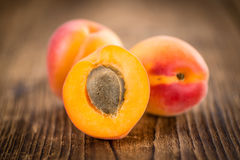 Fresh Apricots on wooden background & x28;selective focus& x29;. Fresh Apricots as high detailed close-up shot on a vintage wooden table & x28;selective focus& Stock Photo