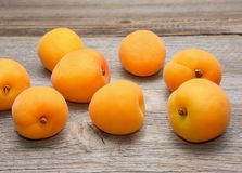 Fresh apricots on wooden background Stock Photo