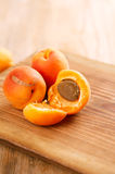 Fresh apricots on wooden table Royalty Free Stock Image