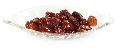 Fresh Arabian Dates on a transparent bowl Royalty Free Stock Photos