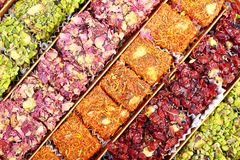 Fresh arabic sweets. Arabic sweets with rose leaves and pistachios , close up shot Stock Photos