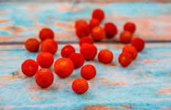 Fresh arbutus. Fruits on  background imitating an old tree. photo with shallow depth of field Royalty Free Stock Image