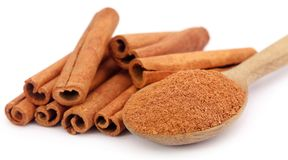 Fresh aromatic cinnamon with powder spice. Bunch of some fresh aromatic cinnamon with powder spice Stock Photo