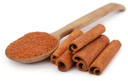 Fresh aromatic cinnamon with powder spice. Bunch of some fresh aromatic cinnamon with powder spice Royalty Free Stock Photography
