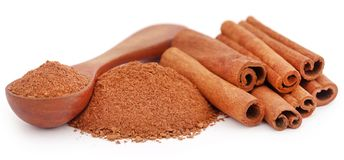 Fresh aromatic cinnamon with powder spice. Bunch of some fresh aromatic cinnamon with powder spice Stock Image