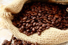 Fresh aromatic coffee beans. In a linen bag Royalty Free Stock Photos