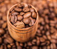 Fresh aromatic coffee beans in a wooden cup Stock Photo