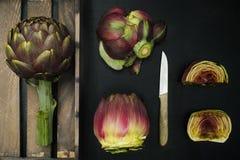 Fresh artichoke green-purple flower heads Royalty Free Stock Image