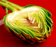 Fresh Artichoke On The Red Plate Royalty Free Stock Photography