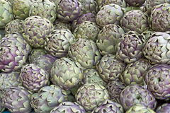 Fresh artichokes. On display, format filling Stock Photos