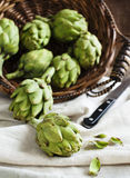 Fresh artichokes in the basket Stock Photo