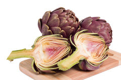Fresh artichokes on a cutting board Stock Image