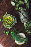 Fresh artichokes on a cutting board. Top view Stock Image