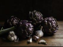 Fresh artichokes and garlic Royalty Free Stock Image