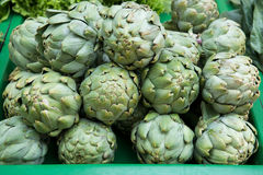 Fresh artichokes at the market. The texture may be used for printing on fabric or paper, as background and in web design stock image