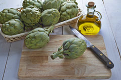 Fresh artichokes to cook Royalty Free Stock Photo
