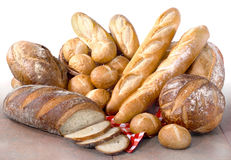 Fresh Artisan Breads. Fresh baked artisan breads on tile Royalty Free Stock Image