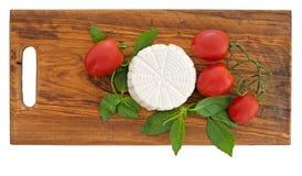 Fresh artisan ricotta cheese tomatoes, basil. Royalty Free Stock Photo