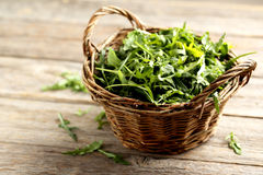 Fresh arugula leafs. On a grey wooden table stock image