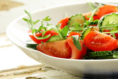 Fresh arugula salad with tomatoes, cucumbers Stock Photography