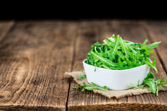 Fresh Arugula selective focus. As detailed close-up shot on vintage background royalty free stock photography