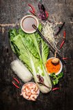 Fresh asian cooking ingredients with rice noodles and shrimps. Stock Images
