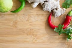 Fresh Asian Cuisine Ingredients on Wooden Board. Vibrant Thai Green Curry Ingredients on Wooden Board Royalty Free Stock Photos