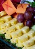 Fresh asian fruit peeled pineapple grape Royalty Free Stock Image