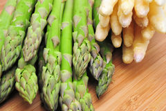 Fresh Asparagus. Green and white Asparagus on a Bamboo cutting board Stock Images
