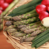 Fresh asparagus in a basket. Freshly harvested green asparagus in a basket Royalty Free Stock Images
