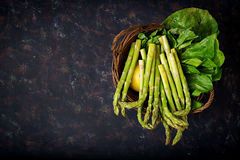 Fresh asparagus in basket. On dark  background Royalty Free Stock Image