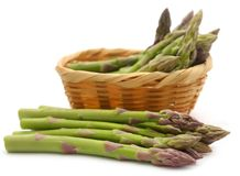 Fresh asparagus in a basket. Over white background Royalty Free Stock Image