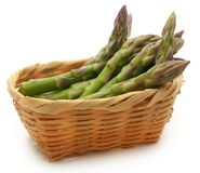 Fresh asparagus in a basket. Over white background Royalty Free Stock Images